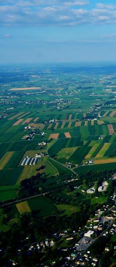 amish-farmland-pennsylvania-farms-fields-taken-hot-air-balloon-golden-hour-lancaster-pa-61590689